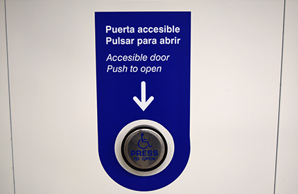 Blue button for entrance doors