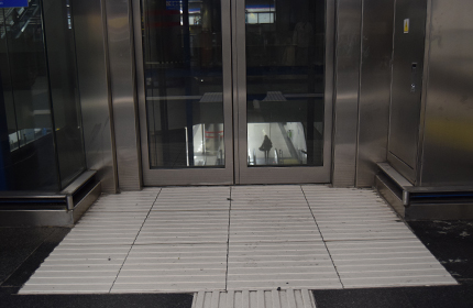 White signs at the entrance of the lifts