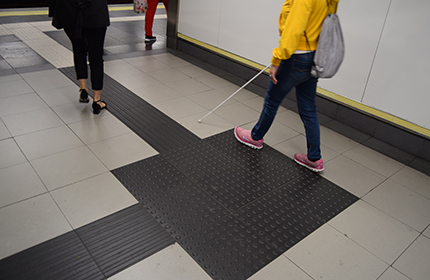 Blind person on a podotactil pavement