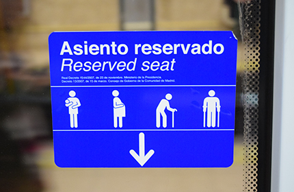 Sign on the window of the seats reserved for elderly, pregnant women and children
