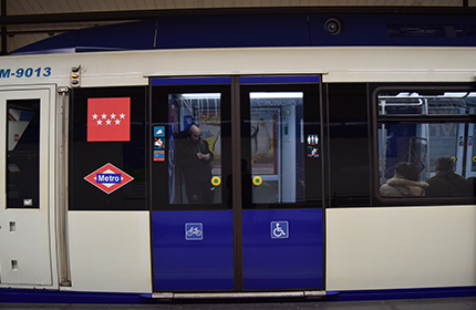 Carriage door with an icon showing the space reserved for wheelchairs