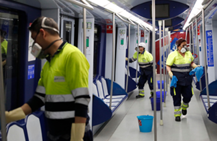 Metro staff disinfecting a carriage
